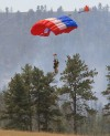 A Smoke Jumper parachutes to the Skibstad Fire