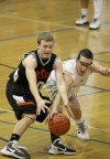 Danny Desin of Billings Senior and Danny Robison of Billings West dive for a loose ball