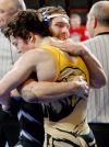 Joe Malchuski hugs Koby Reyes