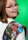 Luella Langlinais shows off badges on her Brownie sash