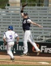 Buzzy Davies of Butte rises to catch a ball at first base