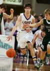 Laurel's Brett Thompson pushes the ball up the floor