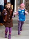 Addison Johns and her sister Caitlin sell Girl Scout cookies