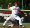 Clint Coulter of Helena slides into Avain Rachal of the Mustangs