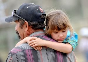 JoleahAnn Parker rests her head on her grandpa's shoulder