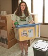Pat Karell moves boxes of her belongings