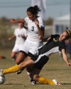 Andrea Emmett of Billings Senior collides with West's Savannah Witt
