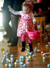 Lydia Skogley runs to pick up eggs