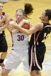 Helena's Mallory Grimsrud grabs a rebound