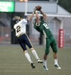 Ian Byorth of Central intercepts a pass