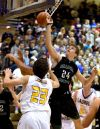Central's Jacob Hadley jumps for a rebound