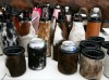 A selection of cowhide can and bottle koozies