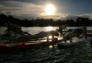 Sunset sessions: Classes combine paddleboard, yoga on Lake Elmo