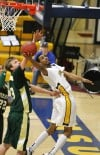 Robert Mayes of Montana State Billings has a shot blocked
