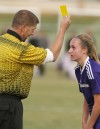 Amanda Peppers of Westminster College recives a yellow card