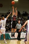 Huntley Project's Zach Tallon puts up a 3-pointer over a Whitehall