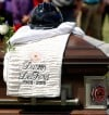 A fire helmet sits on top of Dustin DeFord's casket