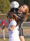 Senior's Emma Woodring, 1, battles West's Haley Tessmer, 3, for the ball
