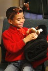 Jaden, 6, checks out the toy, blanket and pillow