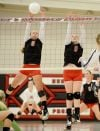 Huntley players block a spike