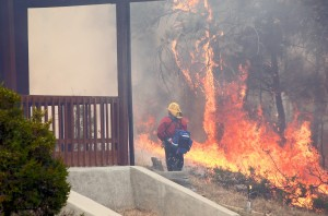 Quick assault keeps wildfire from consuming Shepherd-area home