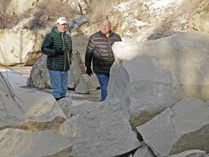 City engineer assessing damage from rock slide