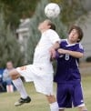 Senior's Wes Currence, 6, and Butte's Cullen Sehulster, 8, battle for the header