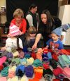 Volunteers give mittens to keep Head Start students warm (and cute)