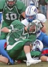 Holden Ryan, 4,is tackled