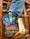 A young cowgirl sports her boots