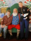 Santa poses with the Stamper brothers