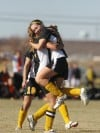 Marta Prosinski of Billings West jumps into Danielle Muri's arms