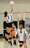 Tessa Hultgren jumps to block Forsyth spike