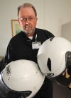 Few argue that helmet use has obvious safety benefits, but riders resist mandate