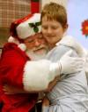 Santa hugs Cameron Hilliard