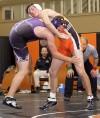 Senior's Luke Paine battles  Forsyth's Quinn Coate