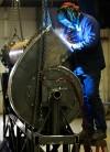 Steven Lee works on a pump