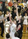 Ty Gilmore of Billings West floats a ball past Lincoln Powers