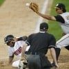 Jefry Sierra, left, slides in safely at home on a wild pitch