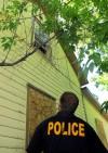 Billings police officer Jon Kristjanson looks up