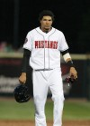 Jonathan Reynoso of the Mustangs takes off his batting helmet