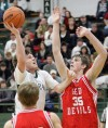 Central's Jacob Stanton, 2, puts up a shot