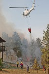 A helicopter douses flames