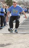 Tony Cripps long jumps