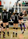 Central attempts to block Laurel's Alix Elliot's spike