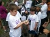 Joshua and Matthew Miller take part in a bird-banding exercise