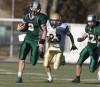 Central quarterback Jacob Stanton carries the ball