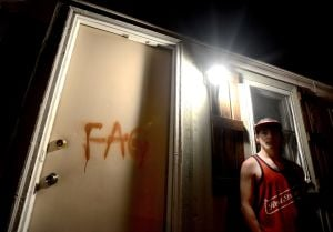 Teen wakes up to find gay slur spray-painted on door