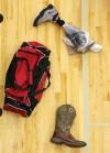 A teammate's boot lays near Koni Dole's prosthetic leg