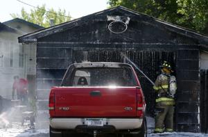 Fire destroys West End garage, spreads to home